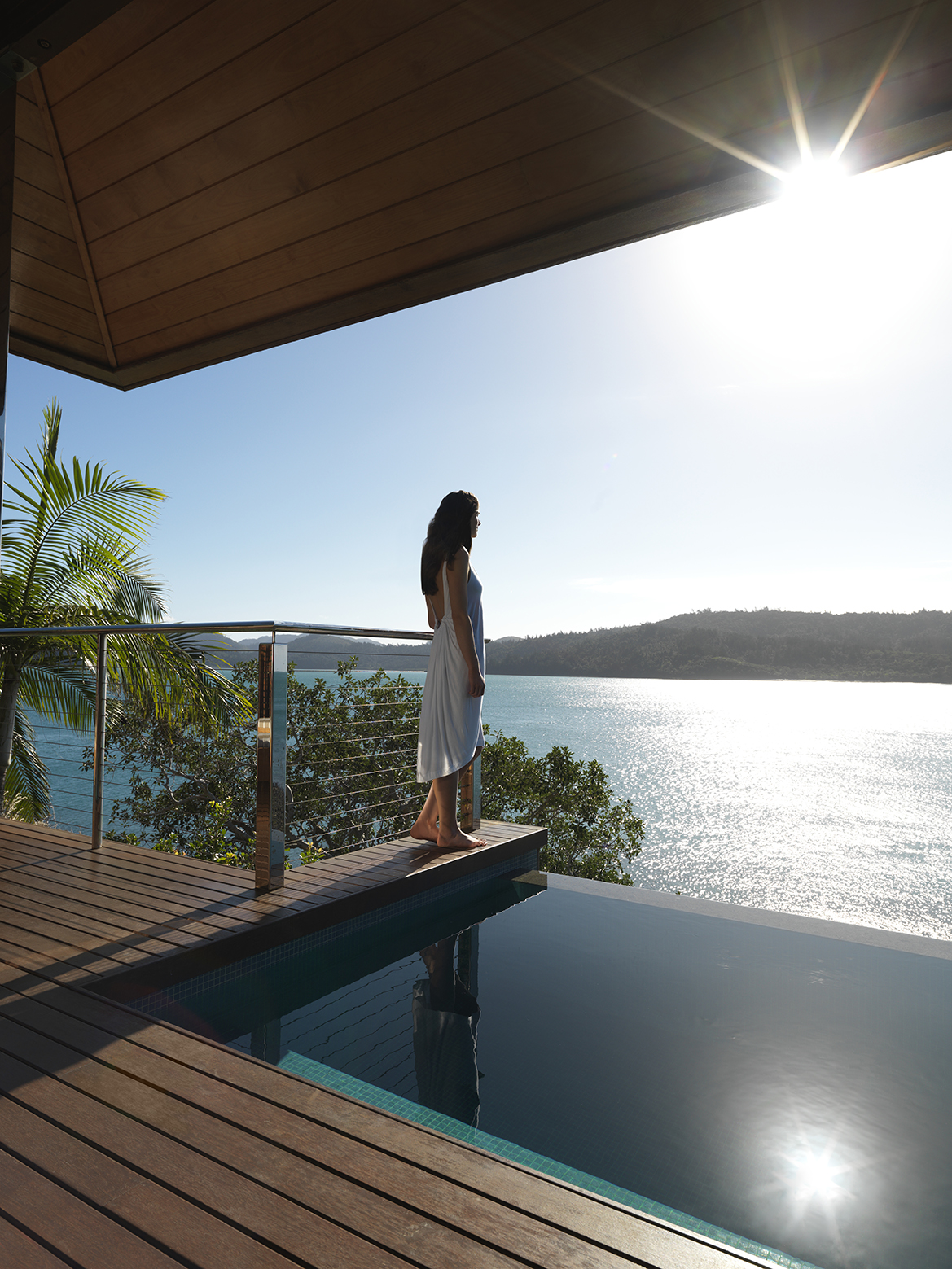 qualia_Great-Barrier-Reef_Woman-Standing-Plunge-Pool - Click to view larger version